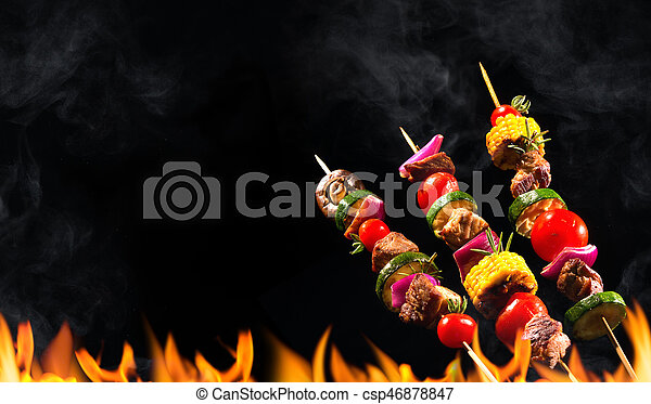 Collage of grilled meat skewers and vegetables - csp46878847