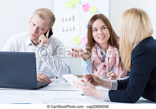 Colleagues discuss in office - csp23806056