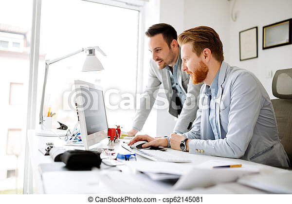 Colleagues working in office - csp62145081