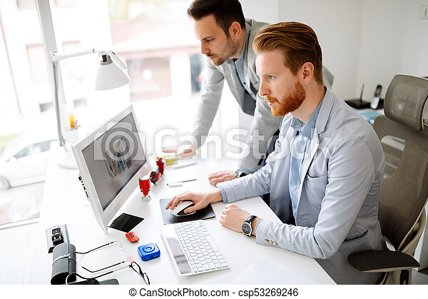 Colleagues working in office - csp53269246