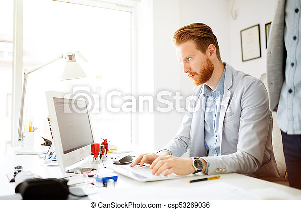 Colleagues working in office - csp53269036