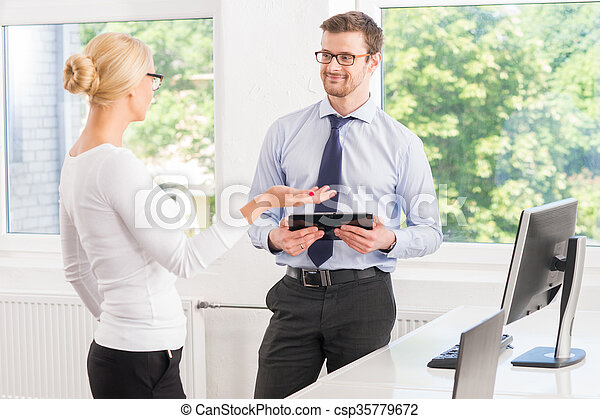 Colleagues working in the office with a tablet - csp35779672