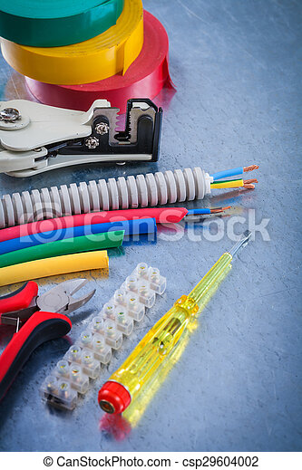 Collection of electrical tools on scratched metallic background - csp29604002