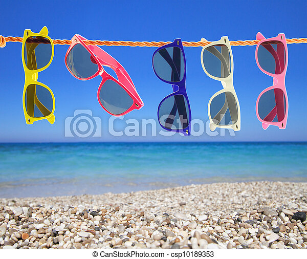 Collection of sunglasses on the beach - csp10189353