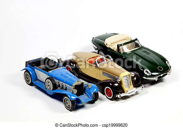 Collection of Three Toy Model Cars on White - csp19999620