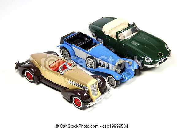 Collection of Three Toy Model Cars on White - csp19999534
