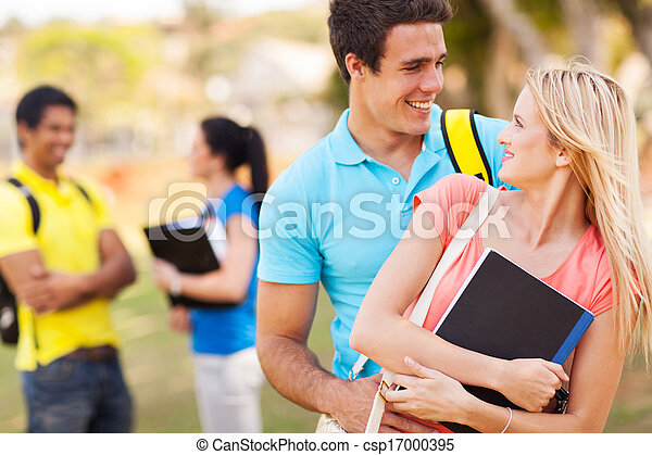 college couple embracing outdoors - csp17000395
