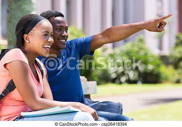 college couple pointing - csp26418394
