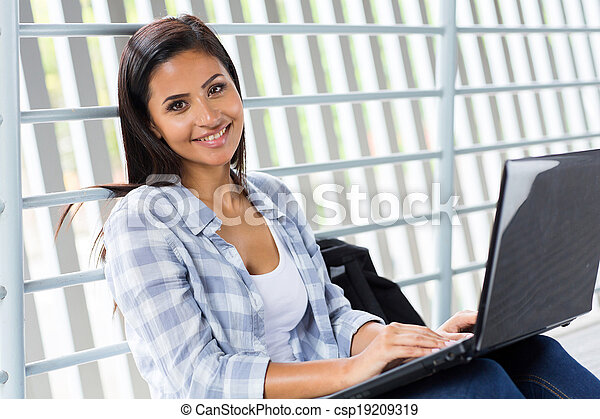 college girl using laptop computer - csp19209319