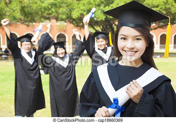 college graduate with happy classmates - csp18660369