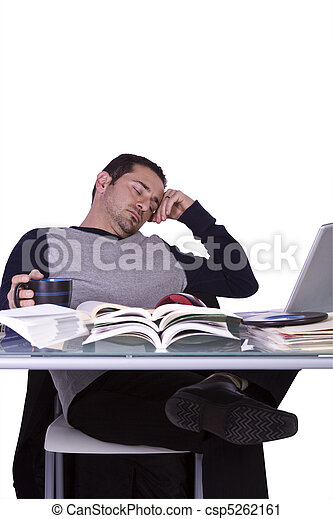 College Student Sleeping on his Desk - csp5262161