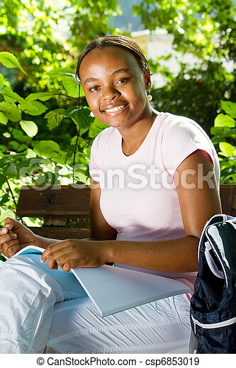 college student studying outdoors - csp6853019