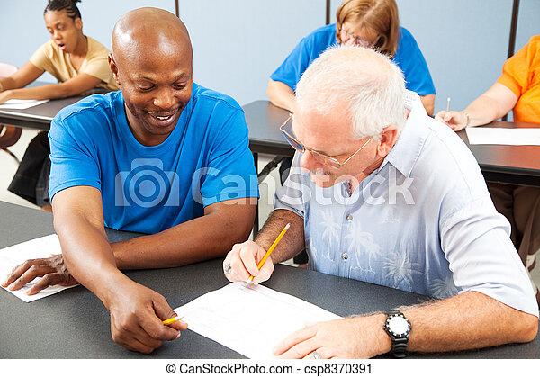 College Student Tutors Older Classmate - csp8370391