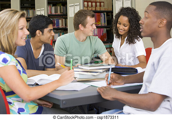 College students studying together in a library - csp1873311