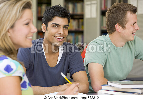 College students studying together in a library - csp1873312