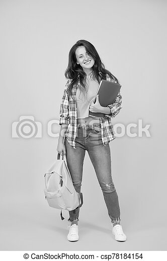 College university education. School girl with backpack. Woman adult student. Final exam and graduation. Dedicated to studying. Student with backpack. Regular student carry workbooks. Student life - csp78184154