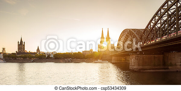 Cologne at sunset - csp53434309