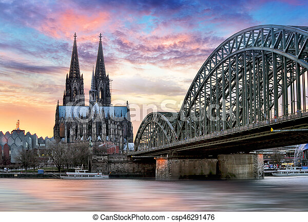 Cologne Cathedral and Hohenzollern Bridge at sunset - night - csp46291476