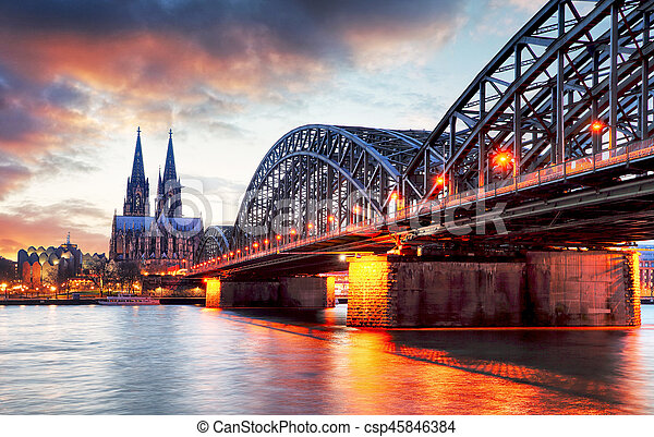 Cologne Cathedral and Hohenzollern Bridge at sunset - night - csp45846384