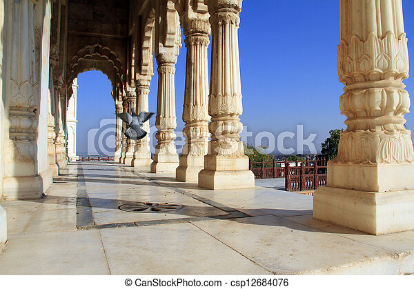 Colonade of white marble columns with flying pigeon - csp12684076