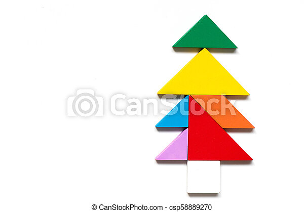 Color wood tangram puzzle in tree shape on white background.
