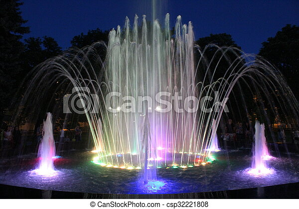 colored fountains in city park in the night - csp32221808