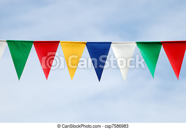 Colored triangular flags on blue sky background - csp7586983