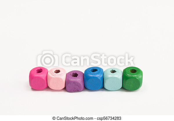 Colored wooden cubes on a white background - csp56734283
