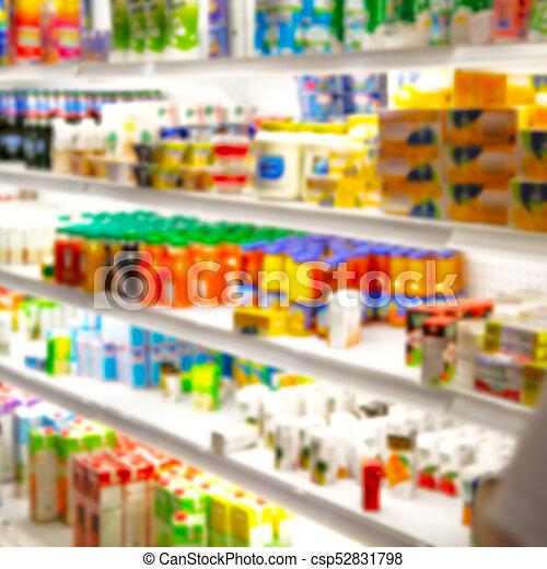 Lleno de colores borrosos en el supermercado - csp52831798