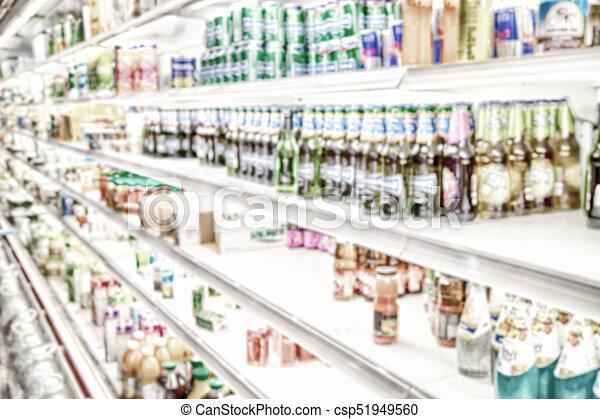 Lleno de colores borrosos en el supermercado - csp51949560