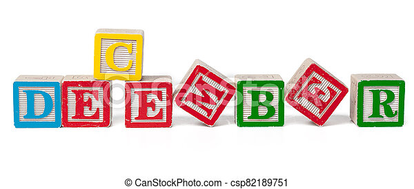 Colorful alphabet blocks. Word december isolated on white background - csp82189751
