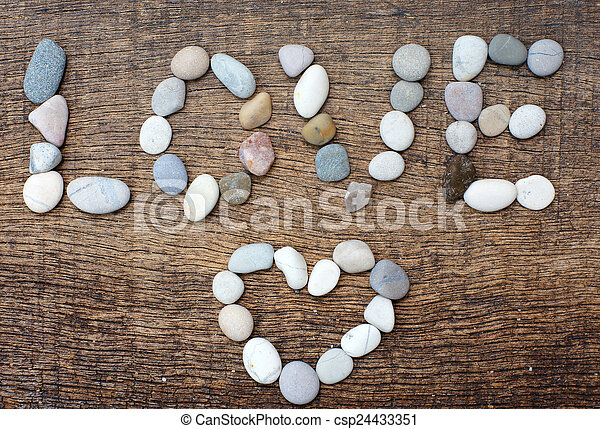 colorful arrangement of stones with a form of the word love and - csp24433351