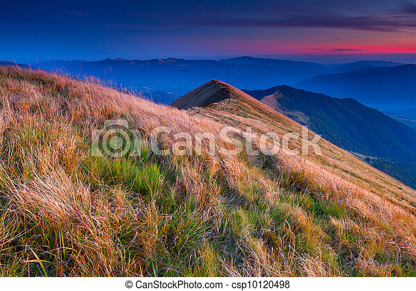 Colorful autumn landscape in the mountains. Sunrise - csp10120498