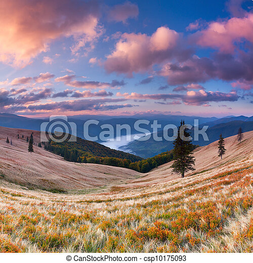 Colorful autumn landscape in the mountains. Sunrise - csp10175093
