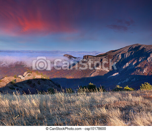 Colorful autumn landscape in the mountains. Sunrise - csp10178600