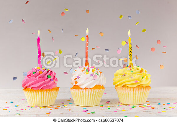 Colorful Birthday Cup Cakes On Wooden Background