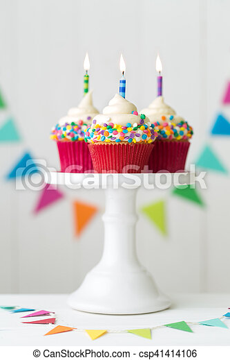 Colorful Birthday Cupcakes On A Cake Stand