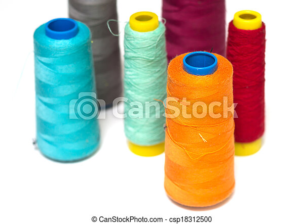 Colorful bobbins isolated on white - csp18312500