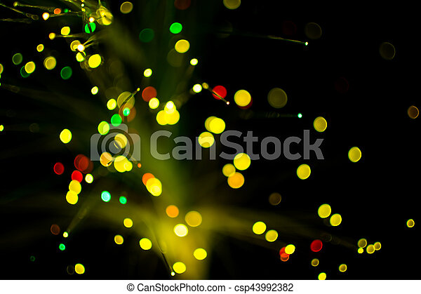 Colorful bokeh circle light celebrate at night, defocus light abstract yello background. - csp43992382