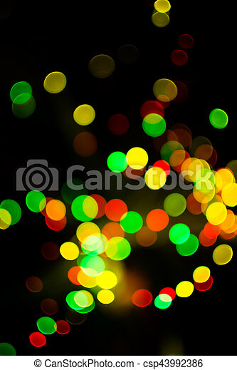 Colorful bokeh light celebrate at night, defocus light abstract yello background. - csp43992386