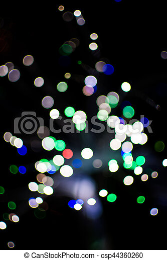Colorful bokeh light celebrate at night, defocus light abstract background. - csp44360260
