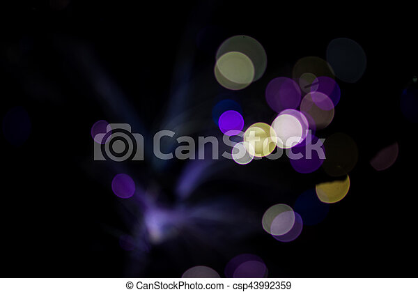Colorful bokeh light celebrate at night, defocus light abstract background. - csp43992359