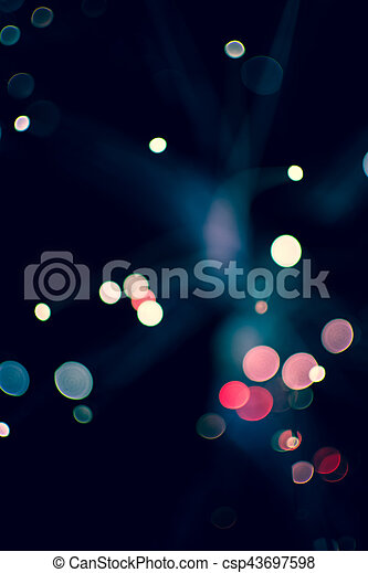 Colorful bokeh light celebrate at night, defocus light abstract background. - csp43697598