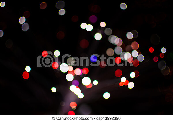 Colorful bokeh light celebrate at night, defocus light abstract background. - csp43992390