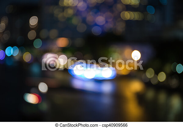 Colorful bokeh of city skyline from the sea in night time - csp40909566