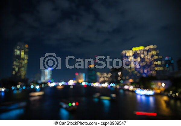 Colorful bokeh of city skyline from the sea in night time - csp40909547