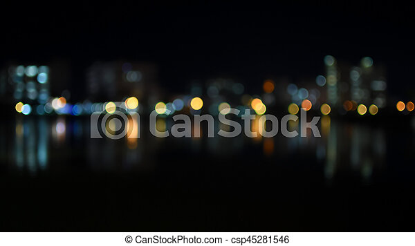 Colorful bokeh of city skyline from the river in night time - csp45281546