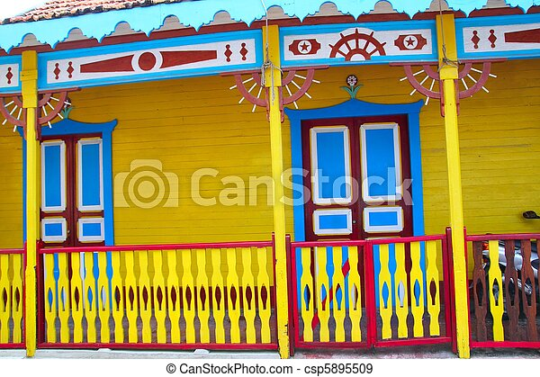 colorful Caribbean houses tropical Isla Mujeres - csp5895509