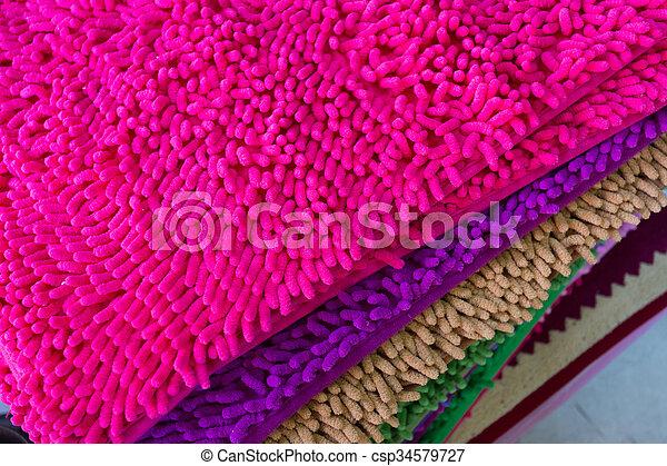 colorful carpet softness texture of doormat, close-up image - csp34579727