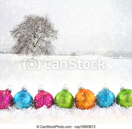 Colorful Christmas balls with snowfield as background - csp16993813